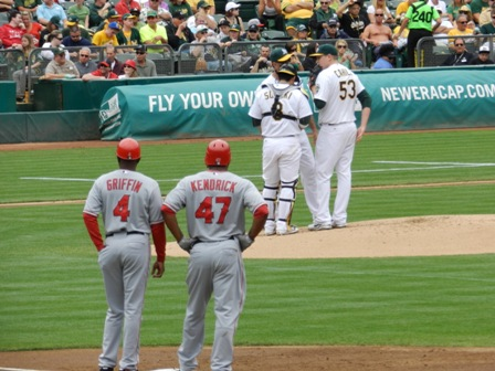 20110716-angels-vs-as-dh-cahill-meeting-on-the-mound-howie-on-1st-for-blog